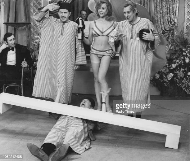 Actors Leon Thau Clive Dunn Margaret Nolan and Spike Milligan in the 'Filthistan Trio' sketch from the television show 'The World of Beachcomber'...