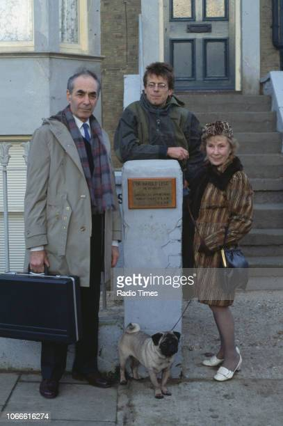 Actors Leonard Fenton Tom Watt and Gretchen Franklin pictured on the exterior set of the BBC soap opera 'EastEnders' April 5th 1991