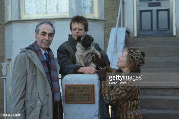 Actors Leonard Fenton Tom Watt and Gretchen Franklin pictured on the exterior set of the BBC soap opera 'EastEnders' September 26th 1986