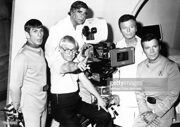Actors Leonard Nimoy DeForest Kelley and William Shatner pose for a portrait with writer Gene Roddenberry and director Robert Wise during the filming...
