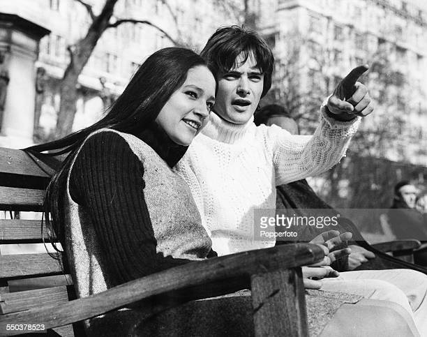 Actors Leonard Whiting and Olivia Hussey stars of the new Zeffirelli film 'Romeo and Juliet' chatting on a park bench London March 6th 1968