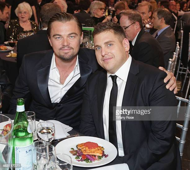 Actors Leonardo DiCaprio and Jonah Hill with Champagne Nicolas Feuillatte attend the 19th Annual Critics' Choice Movie Awards at Barker Hangar on...