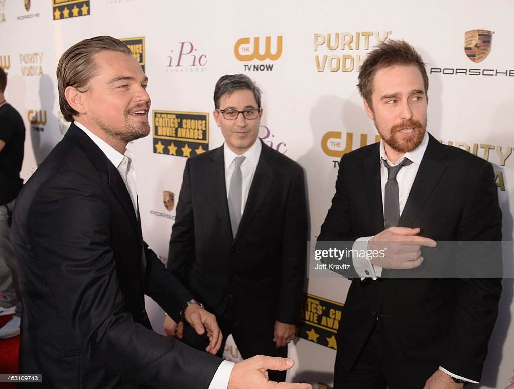 Actors Leonardo DiCaprio (L) and Sam Rockwell (R) attend the 19th Annual Critics' Choice Movie Awards at Barker Hangar on January 16, 2014 in Santa Monica, California.
