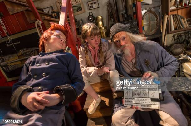 Actors ler Kristoffer Joner Emily Glaister and Eilif H Noraker sit on the movie set of the GermanNorwegian coproduction 'DoktoProktors Pupspulver'...
