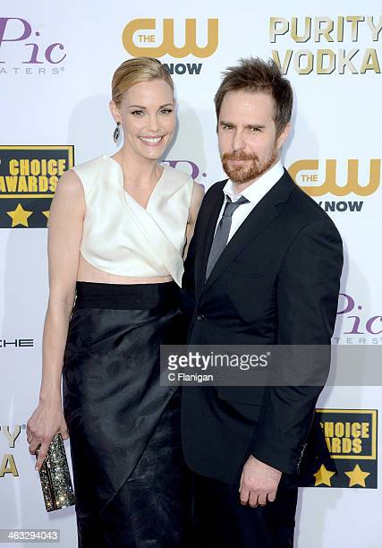 Actors Leslie Bibb and Sam Rockwell arrive at the 19th Annual Critics' Choice Movie Awards at Barker Hangar on January 16 2014 in Santa Monica...