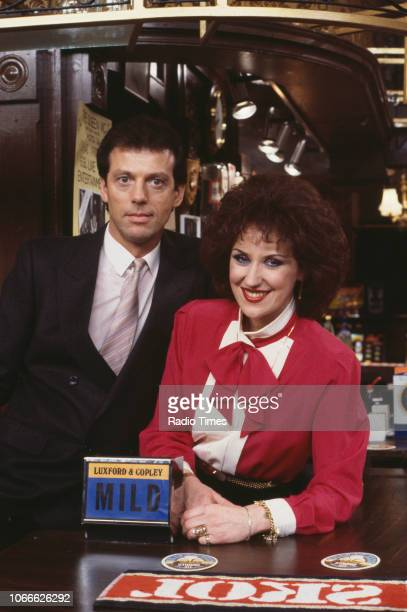 Actors Leslie Grantham and Anita Dobson pictured on the Queen Victoria pub set of the BBC soap opera 'EastEnders' December 30th 1984