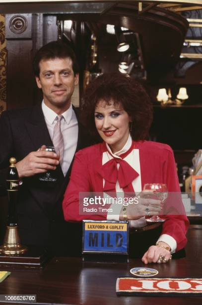 Actors Leslie Grantham and Anita Dobson pictured on the Queen Victoria pub set of the BBC soap opera 'EastEnders' December 18th 1985