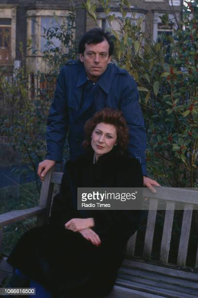 Actors Leslie Grantham and Jane How pictured on the exterior set of the BBC soap opera 'EastEnders' January 10th 1985
