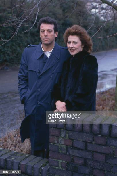 Actors Leslie Grantham and Jane How pictured on the exterior set of the BBC soap opera 'EastEnders', January 10th 1985.