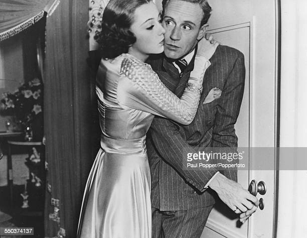 Actors Leslie Howard and Olivia de Havilland in a scene from the film 'It's Love I'm After' 1937