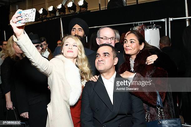 Actors Leven Rambin and Waris Ahluwalia novelist Salman Rushdie designer Bibhu Mohapatra and producer Shruti Ganguly attend the Bibhu Mohapatra Fall...
