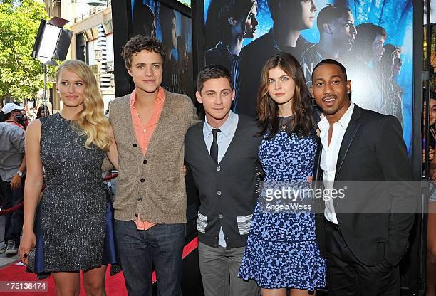 Actors Leven Rambin Douglas Smith Logan Lerman Alexandra Daddario and Brandon T Jackson arrive at the premiere of 'Percy Jackson Sea Of Monsters' at...