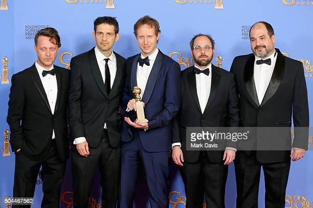 Actors Levente Molnar and Geza Rohrig director Laszlo Nemes producers Gabor Sipos and Gabor Rajna winners of Best Foreign Language Film for 'Son of...