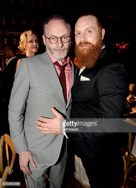 Actors Liam Cunningham and Kristofer Hivju attend the after party at the premiere for the sixth season of HBO's 'Game Of Thrones' at TCL Chinese...