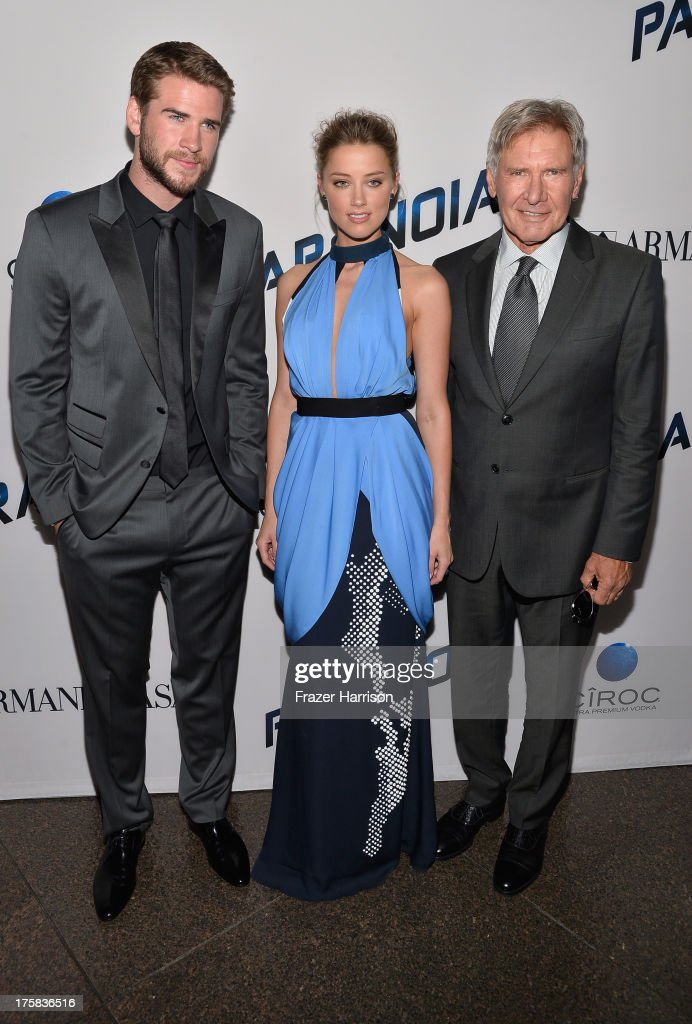 Actors Liam Hemsworth, Amber Heard and Harrison Ford attend the premiere of Relativity Media's 'Paranoia' at DGA Theater on August 8, 2013 in Los Angeles, California.