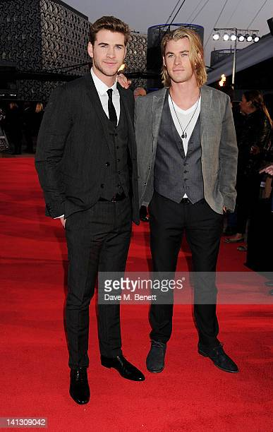 Actors Liam Hemsworth and Chris Hemsworth arrive at the European Premiere of 'The Hunger Games' at the O2 Arena on March 14, 2012 in London, England.