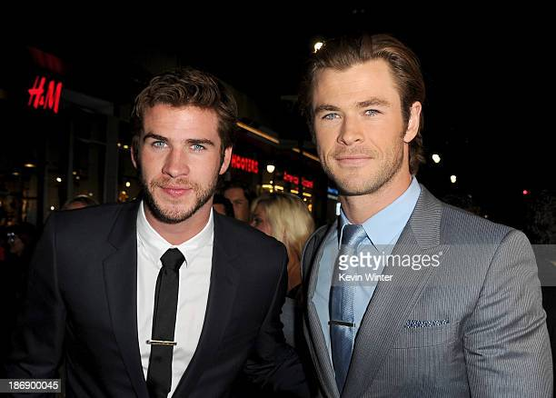 Actors Liam Hemsworth and Chris Hemsworth arrive at the premiere of Marvel's Thor The Dark World at the El Capitan Theatre on November 4 2013 in...