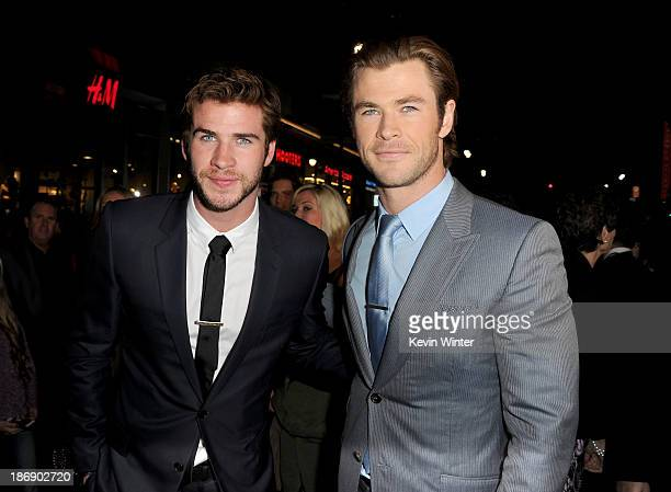 """Actors Liam Hemsworth and Chris Hemsworth arrive at the premiere of Marvel's """"Thor: The Dark World"""" at the El Capitan Theatre on November 4, 2013 in..."""
