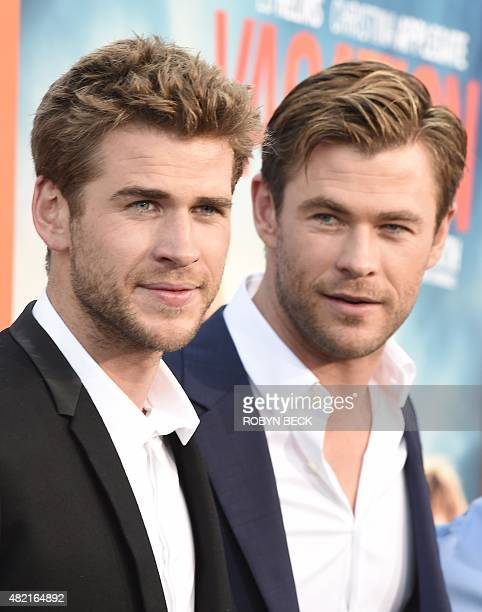 """Actors Liam Hemsworth and Chris Hemsworth arrive for the premiere of Warner Bros' """"Vacation"""" at the Regency Village Theatre in Los Angeles on July..."""