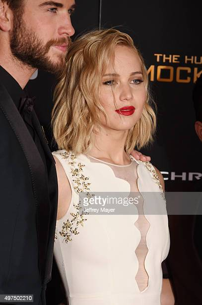 Actors Liam Hemsworth and Jennifer Lawrence arrive at the premiere of Lionsgate's 'The Hunger Games Mockingjay Part 2' at Microsoft Theater on...
