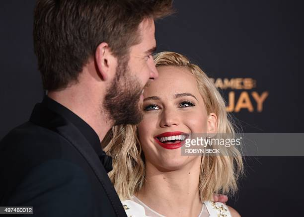 """Actors Liam Hemsworth and Jennifer Lawrence attend the premiere of """"The Hunger Games: Mockingjay - Part 2"""" at the Microsoft Theater in Los Angeles,..."""
