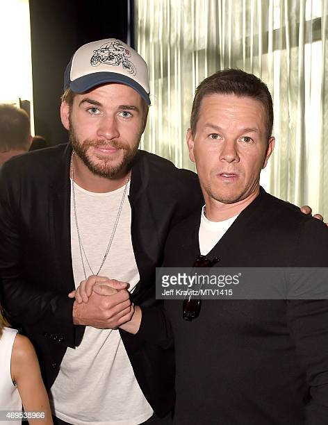 Actors Liam Hemsworth and Mark Wahlberg attend The 2015 MTV Movie Awards at Nokia Theatre LA Live on April 12 2015 in Los Angeles California