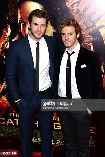 """Actors Liam Hemsworth and Sam Claflin attend a special screening of """"The Hunger Games: Catching Fire"""" on November 20, 2013 in New York City."""