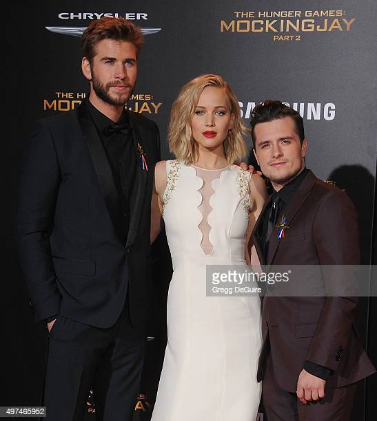 """Actors Liam Hemsworth, Jennifer Lawrence and Josh Hutcherson arrive at the premiere of Lionsgate's """"The Hunger Games: Mockingjay - Part 2"""" at..."""