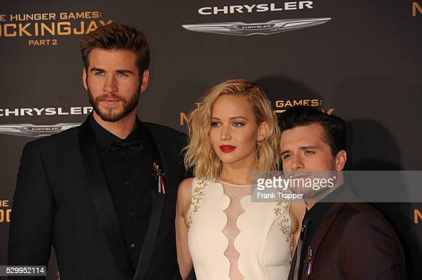 Actors Liam Hemsworth Jennifer Lawrence and Josh Hutcherson arrive at the premiere of The Hunger Games Mockingjay Part 2 held at the Microsoft Theater