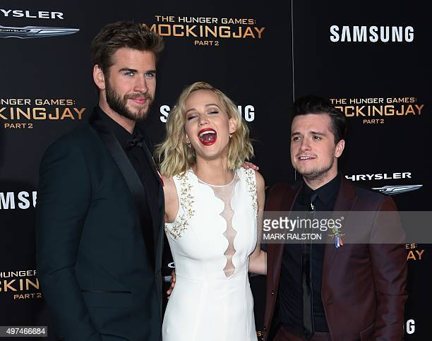 Actors Liam Hemsworth, Jennifer Lawrence and Josh Hutcherson arrive for the premiere of Lionsgate's 'The Hunger Games: Mockingjay - Part 2' at...