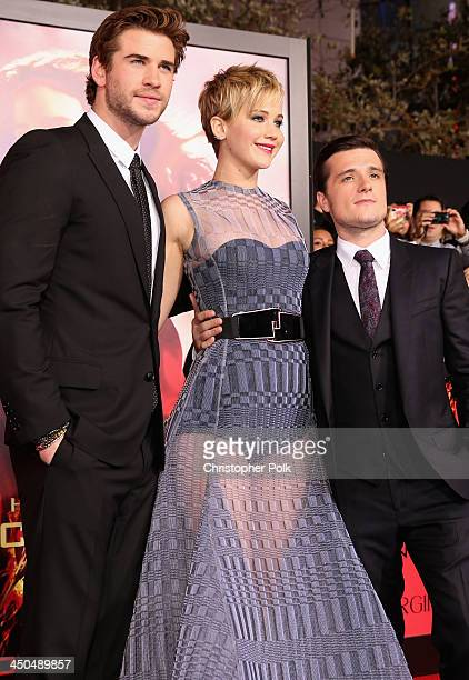 Actors Liam Hemsworth Jennifer Lawrence and Josh Hutcherson attend premiere of Lionsgate's The Hunger Games Catching Fire Red Carpet at Nokia Theatre...
