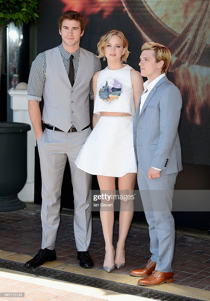 Actors Liam Hemsworth, Jennifer Lawrence and Josh Hutcherson attend 'The Hunger Games: Mockingjay Part 1' photocall at the 67th Annual Cannes Film Festival on May 17, 2014 in Cannes, France.