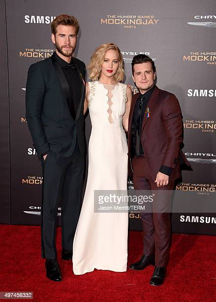 Actors Liam Hemsworth Jennifer Lawrence and Josh Hutcherson attend the premiere of Lionsgate's The Hunger Games Mockingjay Part 2 at Microsoft...