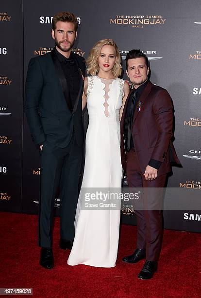 Actors Liam Hemsworth Jennifer Lawrence and Josh Hutcherson attend the premiere of Lionsgate's 'The Hunger Games Mockingjay Part 2' at Microsoft...