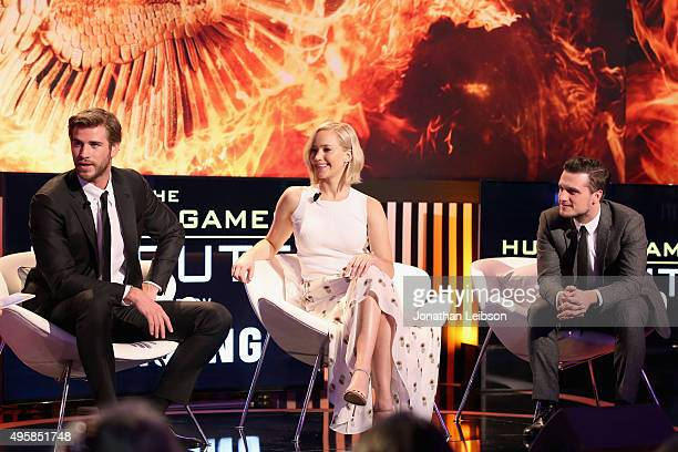 Actors Liam Hemsworth, Jennifer Lawrence, and Josh Hutcherson speak onstage during the Hunger Games Tribute Event Powered By Samsung at the Samsung...