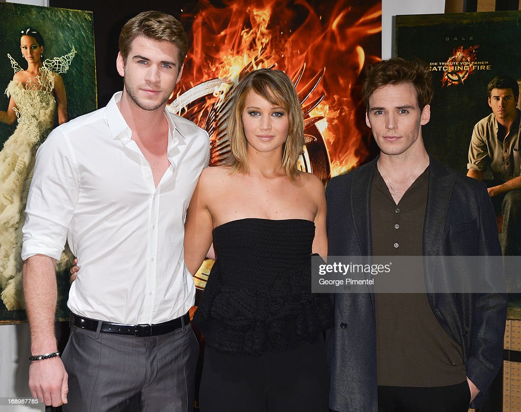Actors Liam Hemsworth, Jennifer Lawrence and Sam Claflin attend the photocall for 'The Hunger Games: Catching Fire' at The 66th Annual Cannes Film Festival at Majestic Hotel on May 18, 2013 in Cannes, France.