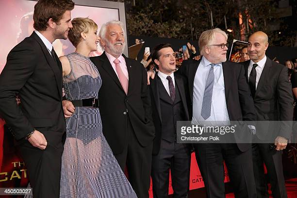 Actors Liam Hemsworth Jennifer Lawrence Donald Sutherland Josh Hutcherson Philip Seymour Hoffman and Stanley Tucci attend premiere of Lionsgate's The...