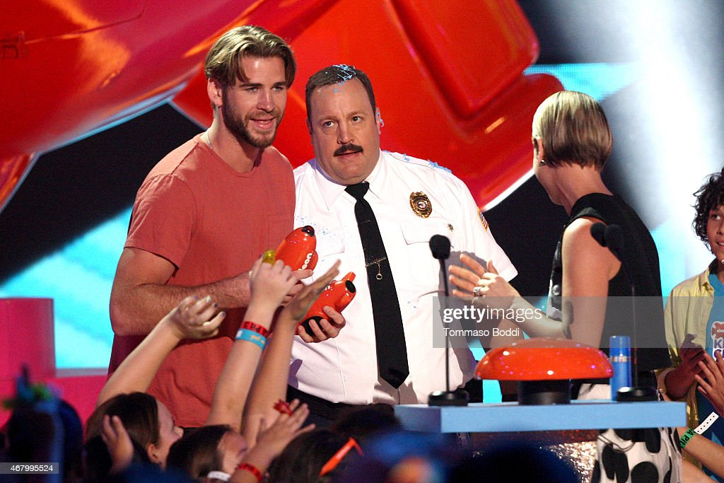 Actors Liam Hemsworth, Kevin James and Kaley Cuoco and speak onstage during attends the Nickelodeon's 28th Annual Kids' Choice Awards held at The Forum on March 28, 2015 in Inglewood, California.
