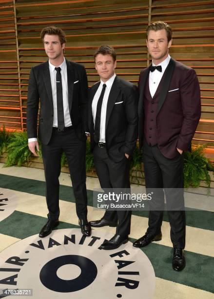 Actors Liam Hemsworth, Luke Hemsworth, and Chris Hemsworth attend the 2014 Vanity Fair Oscar Party Hosted By Graydon Carter on March 2, 2014 in West...