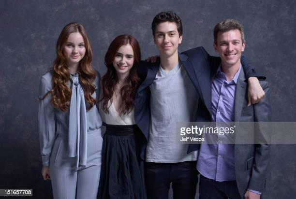 "Actors Liana Liberato, Lily Collins, Nat Wolff and director Josh Boone of ""Writers"" pose at the Guess Portrait Studio during 2012 Toronto..."