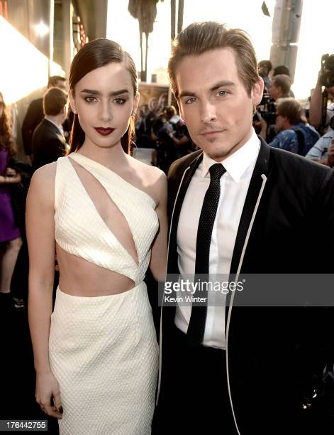 Actors Lily Collins and Kevin Zegers arrive at the premiere of Screen Gems Constantin Films' The Mortal Instruments City Of Bones at the Cinerama...