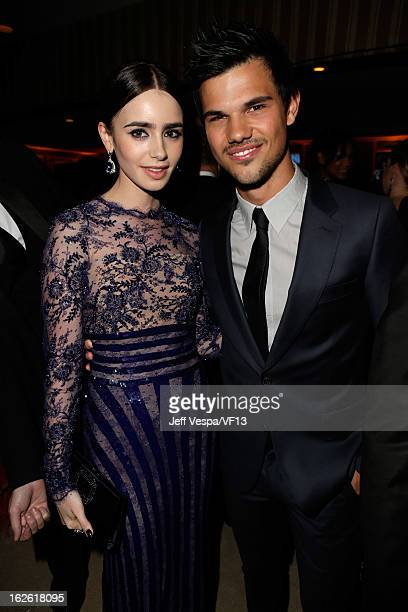 Actors Lily Collins and Taylor Lautner attend the 2013 Vanity Fair Oscar Party hosted by Graydon Carter at Sunset Tower on February 24 2013 in West...