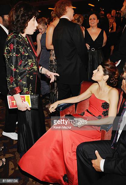 Actors Lily Tomlin and Marisa Tomei watch from the audience during the 62nd Annual Tony Awards at Radio City Music Hall on June 15 2008 in New York...