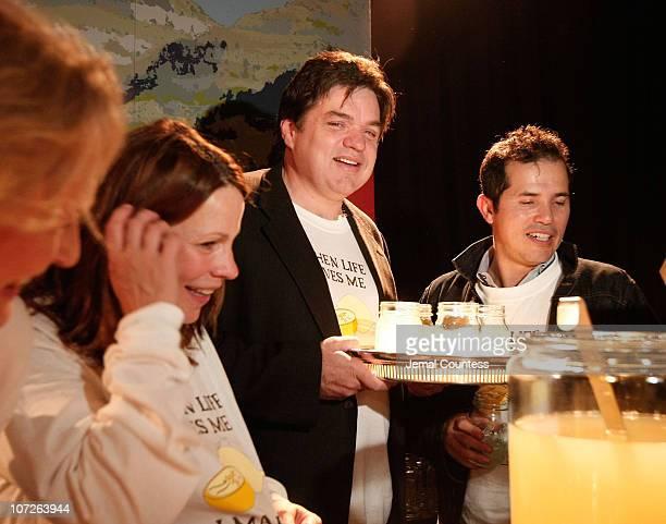Actors Lily Tyler Oliver Platt and John Lequizamo serve Lemonade at the The Sundance Institute's 26th Annual Sundance Family Celebration at 583 Park...