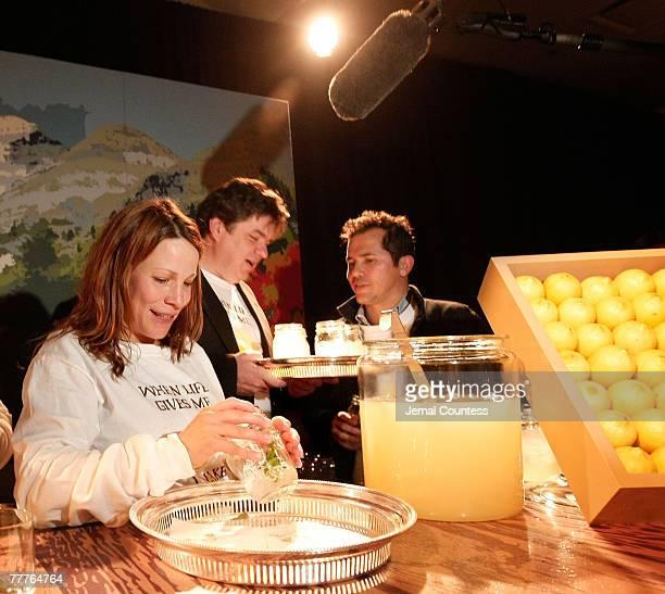 Actors Lily Tyler Oliver Platt and John Lequizamo serve Lemonade at the The Sundance Institute's 6th Annual Sundance Family Celebration at 583 Park...