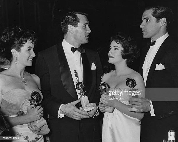 Actors Linda Cristal Rock Hudson Susan Kohner and John Gavin holding their awards at the Foreign Press Awards or the Golden Globes at the Cocoanut...
