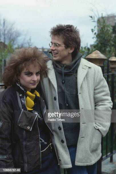 Actors Linda Davidson and Tom Wtt pictured on the exterior set of the BBC soap opera 'EastEnders' November 21st 1984