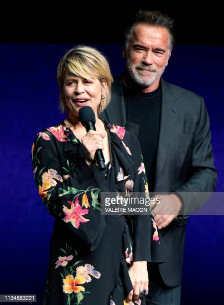 Actors Linda Hamilton and Arnold Schwarzenegger speak on stage during the CinemaCon Paramount Pictures Exclusive Presentation at the Colosseum...