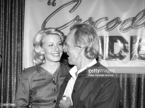 Actors Linda Kozlowski and Paul Hogan attend a press conference to promote their new film 'Crocodile Dundee II' in 1988 in Sydney, Australia.