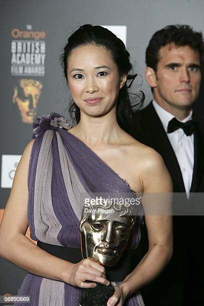 Actors Linh Dan Pham with the award for Film Not in the English Language for The Beat That My Heart Skipped and Matt Dillon pose in the Awards Room...